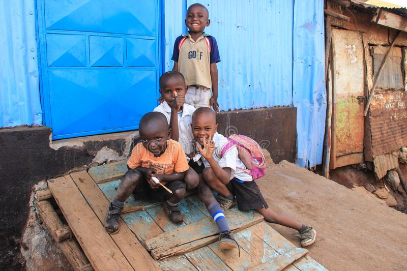 A group of poor children at a burnout hut in slums. Kibera, Nairobi, Kenya - February 13, 2015: A group of poor children at a burnout hut in slums royalty free stock photography