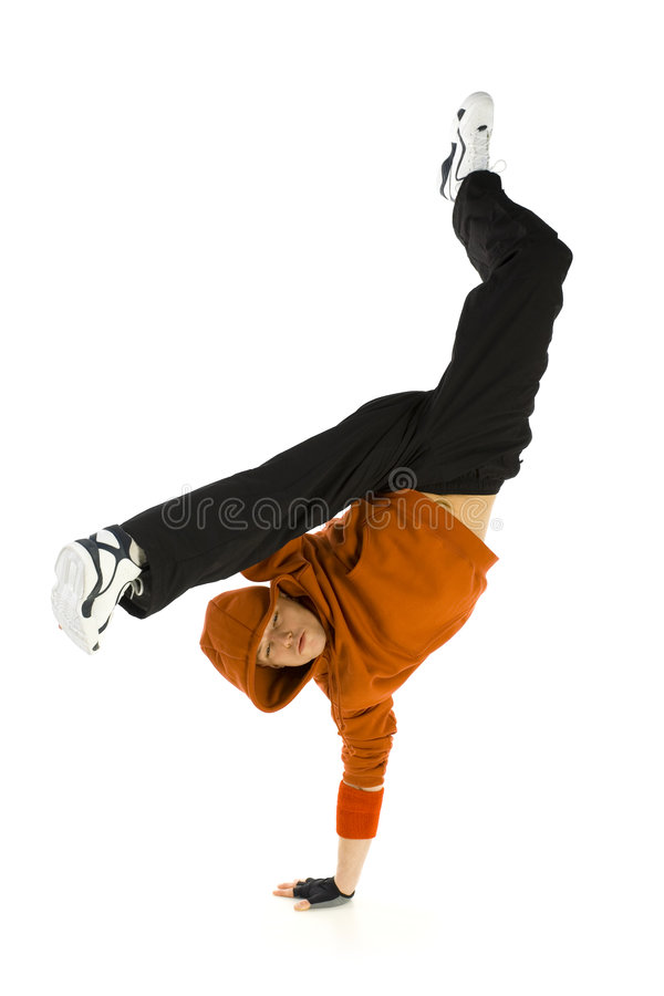Kick. Young hooded bboy standing on one hand. Holding legs in air. Looking at camera. Isolated on white in studio. Front view, whole body