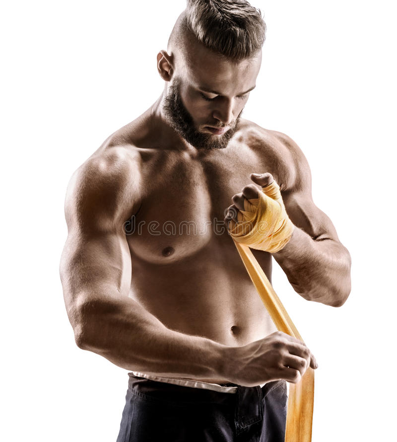 Kick-boxer preparing his fists for a fight. royalty free stock images