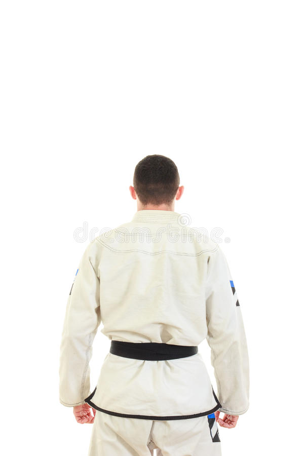 Kickbox fighter wearing kimono with black belt in back view royalty free stock photography