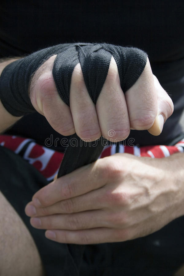 Kickboxer or muay thai fighter equips and trains stock photography