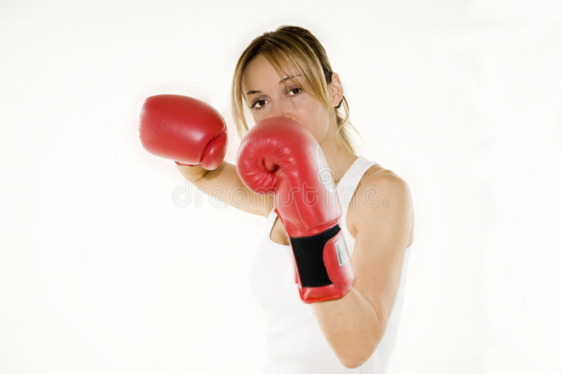 Kickboxer woman training. Young kickboxer woman training, isolated royalty free stock photo