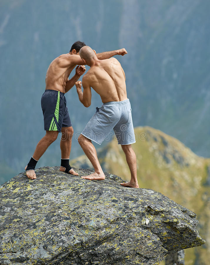 Kickboxers or muay thai fighters training on a mountain cliff stock photos