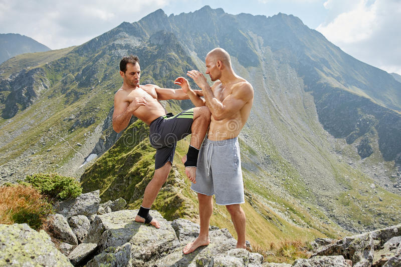 Kickboxers or muay thai fighters training in the mountains. Sparring stock images