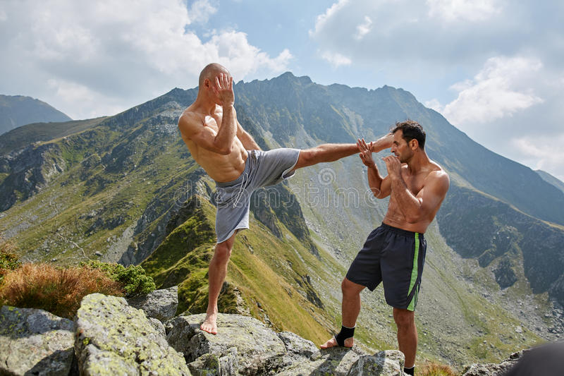 Kickboxers or muay thai fighters training in the mountains. Sparring royalty free stock images