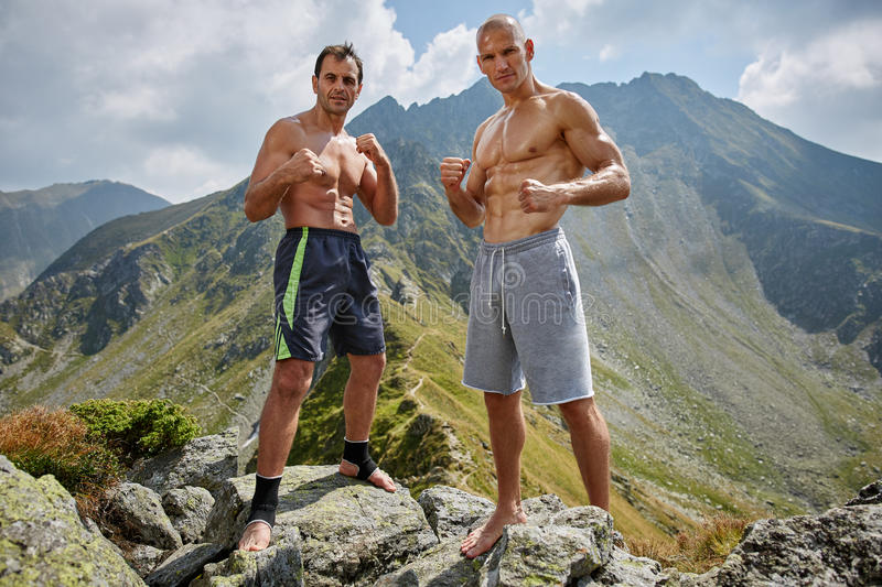 Kickboxers or muay thai fighters training in the mountains. Sparring stock photography