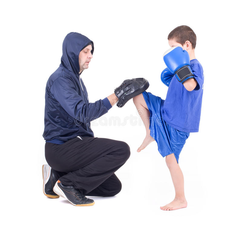 Kickboxing kids with instructor. Isolated on a white background. Studio shot royalty free stock images