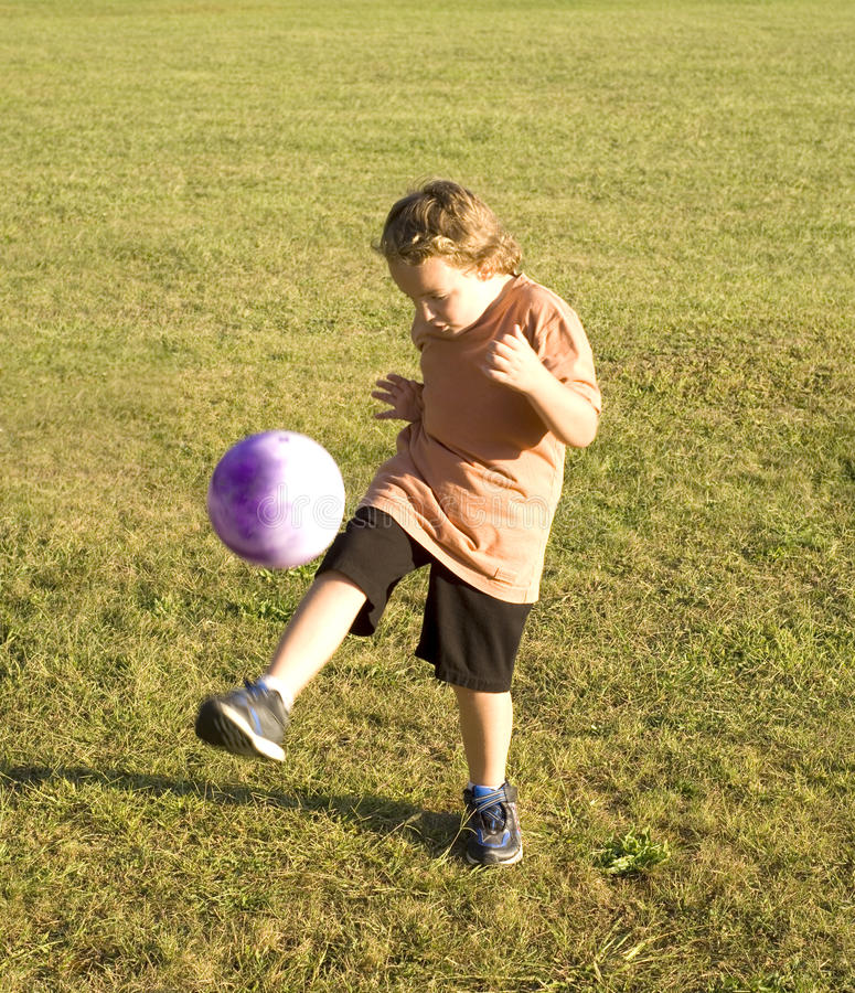 Download Kicking The Ball stock photo. Image of sports, foot, young - 10835480