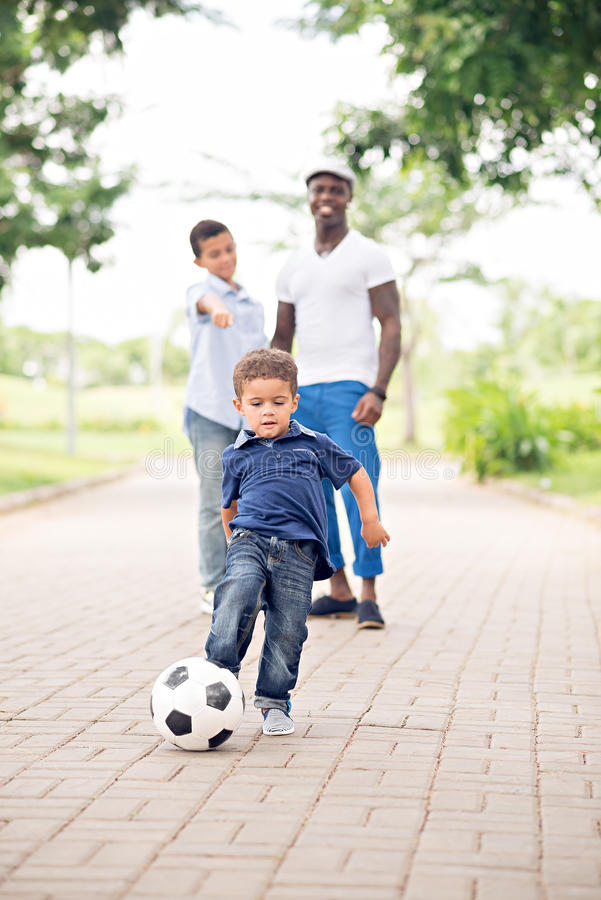 Kicking soccer ball stock photo