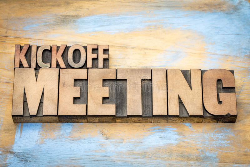 Kickoff meeting word abstract in wood type royalty free stock photo