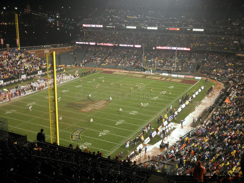 A kickoff play during the 2009 Emerald Bowl. Trojans 24 vs. Boston College 13, taken from the upper deck at ATT park in San Francisco California on a rainy royalty free stock photo