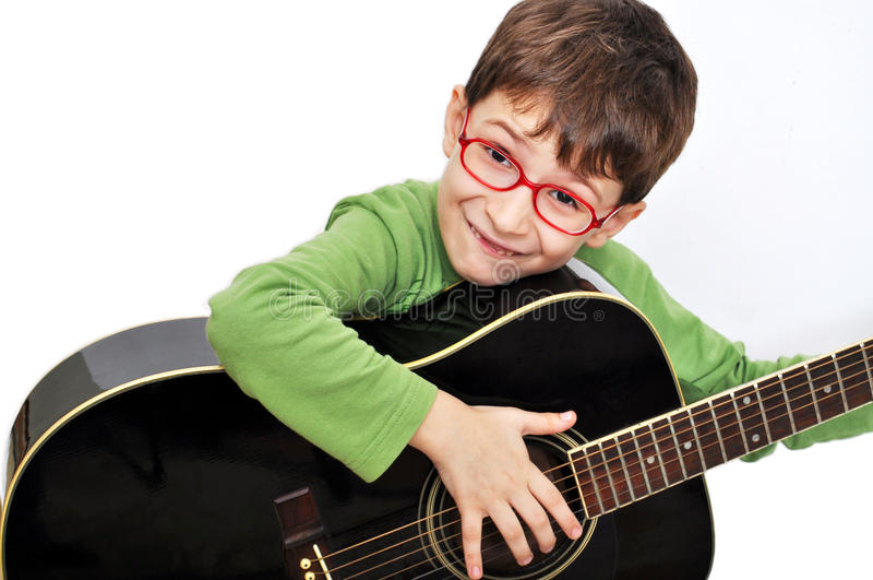 Kid with acoustic guitar. A over white background stock photography