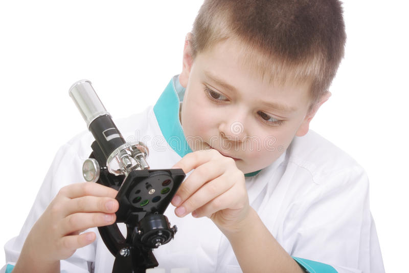 Download Kid Adjusting Microscope Stock Photography - Image: 13504122