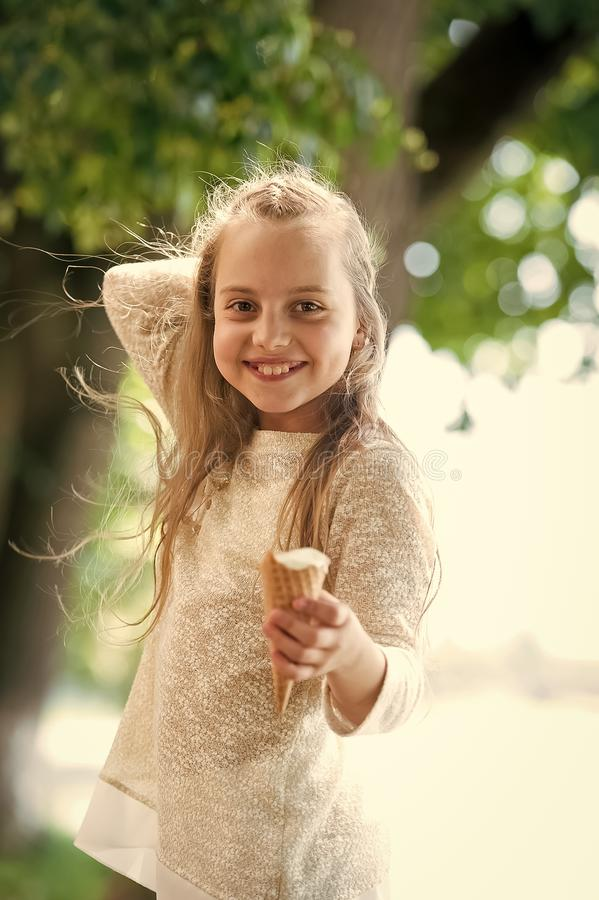 Kid with adorable smile, long blond hair with ice cream royalty free stock photo