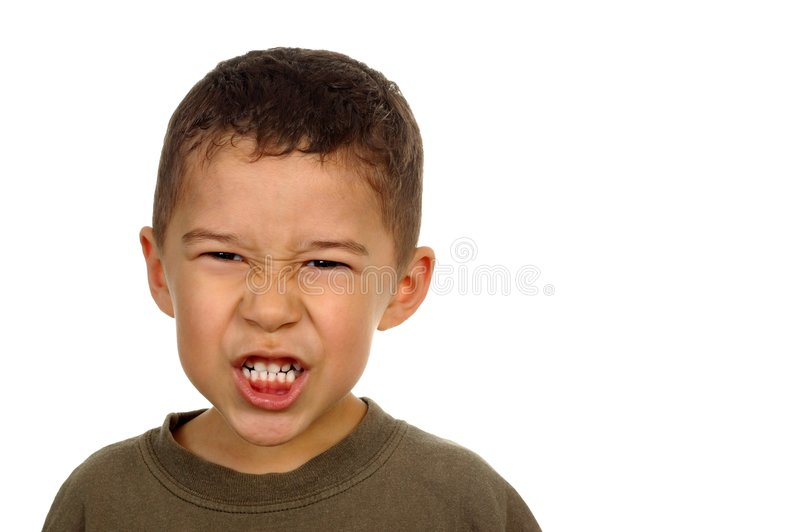 Kid with angry face, five years. Hispanic boy with a mad expression, isolated on white background stock photos