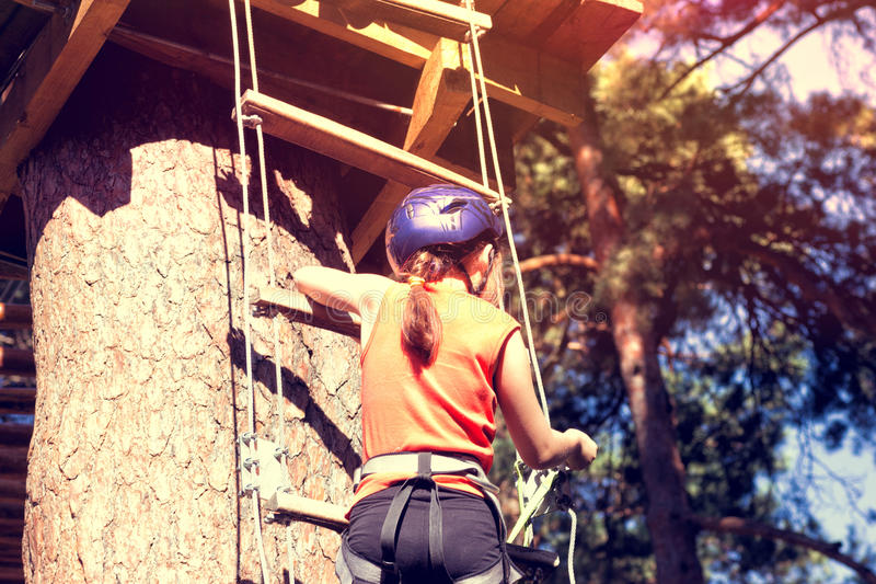 Kid athlete. Belay climbing outfit stock photo