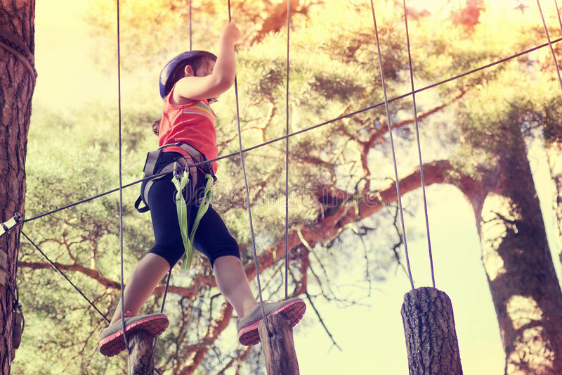 Kid athlete. Belay climbing outfit stock images