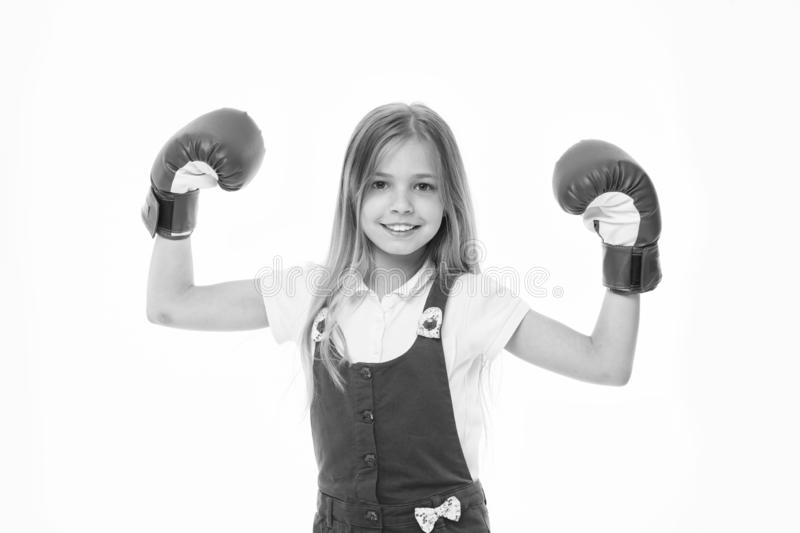 Kid athlete show power. Happy child in boxing gloves isolated on white. Little girl smile before training or workout. Childhood and childcare. Sport activity stock photo