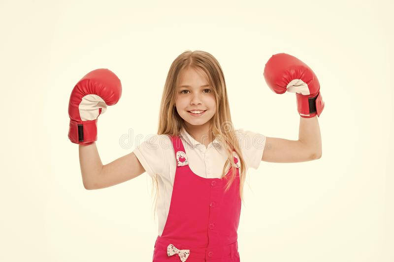Kid athlete show power. Happy child in boxing gloves isolated on white. Little girl smile before training or workout. Childhood and childcare. Sport activity stock photos