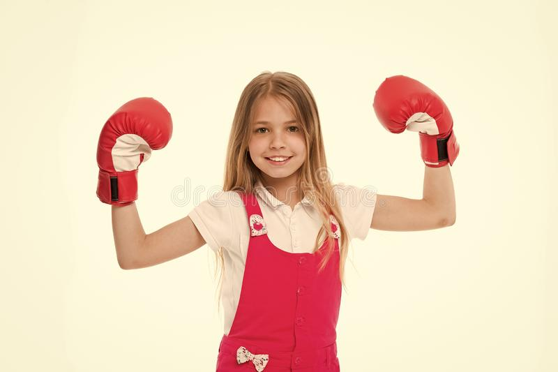 Kid athlete show power. Happy child in boxing gloves isolated on white. Little girl smile before training or workout. Childhood and childcare. Sport activity stock photography