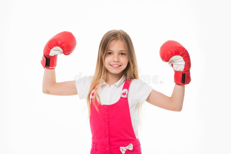 Kid athlete show power. Happy child in boxing gloves isolated on white. Little girl smile before training or workout. Childhood and childcare. Sport activity royalty free stock photography