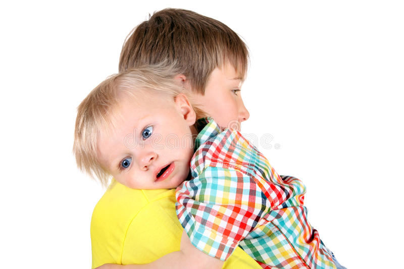 Kid and Baby Boy. Kid and Tired Baby Boy Isolated on the White Background stock image