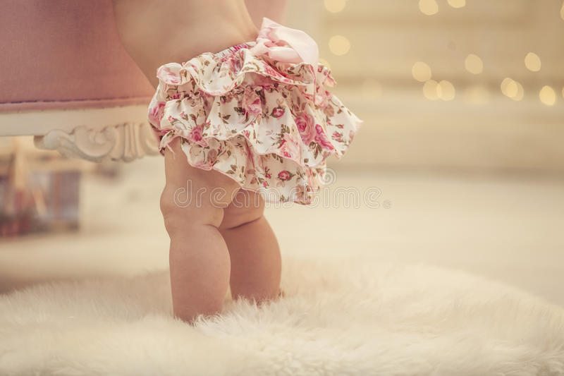 Kid baby girl in pink clothes and happy interior royalty free stock photo