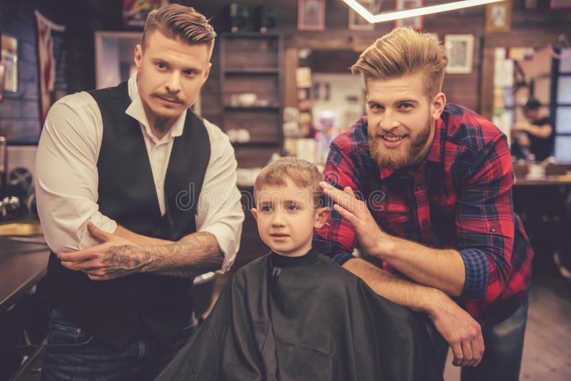 Kid at the barber shop stock photography