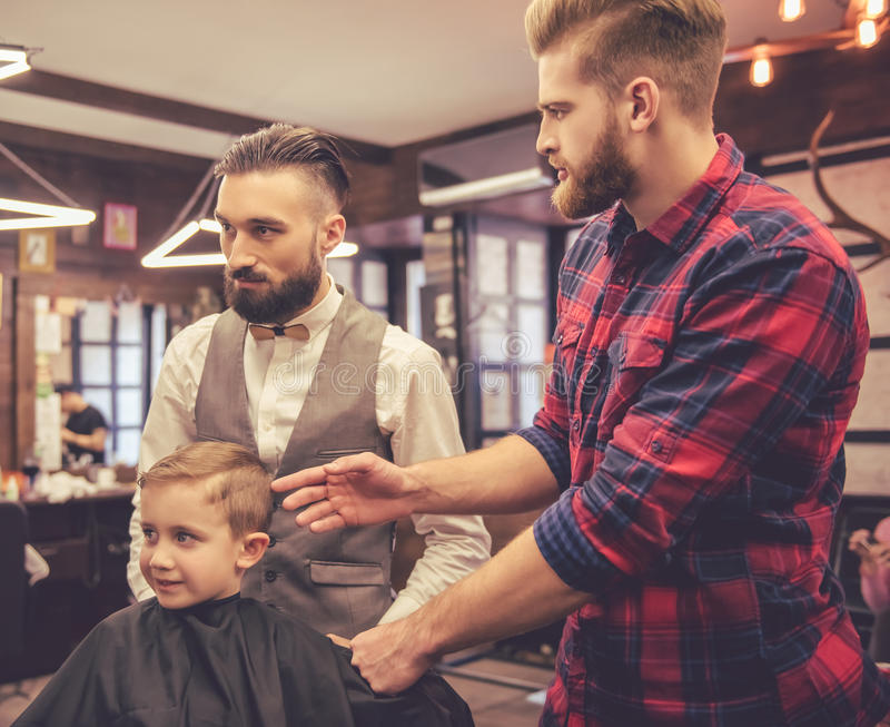 Kid at the barber shop stock photo
