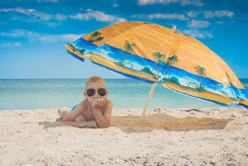 Kid on a beach 3 stock photo