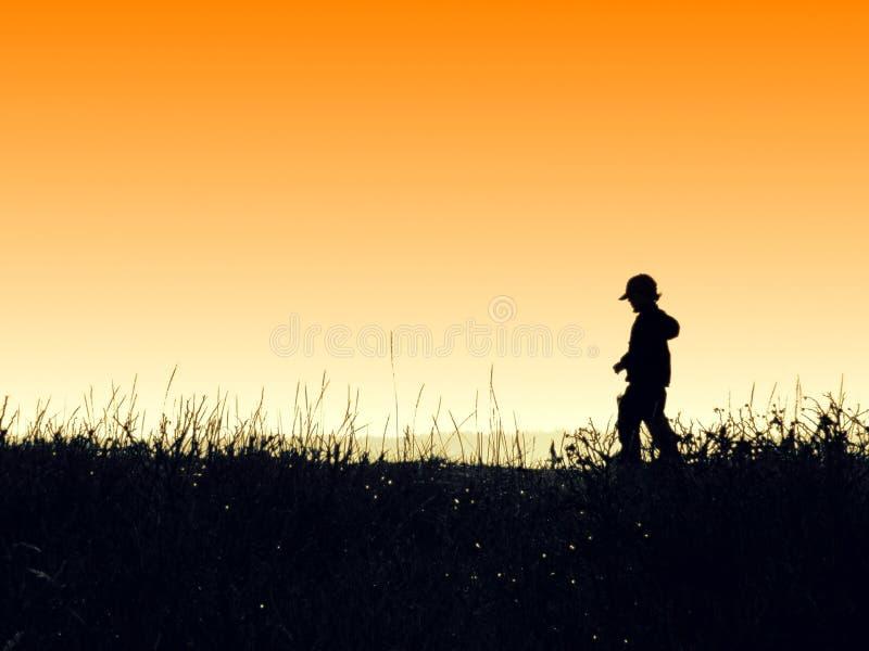 Kid on the beach: orange stock image