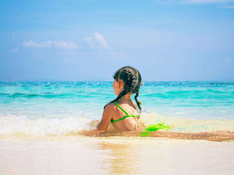 Kid on the beach. Beach tropical vacation caucasian kid girl with playing at the sand stock images
