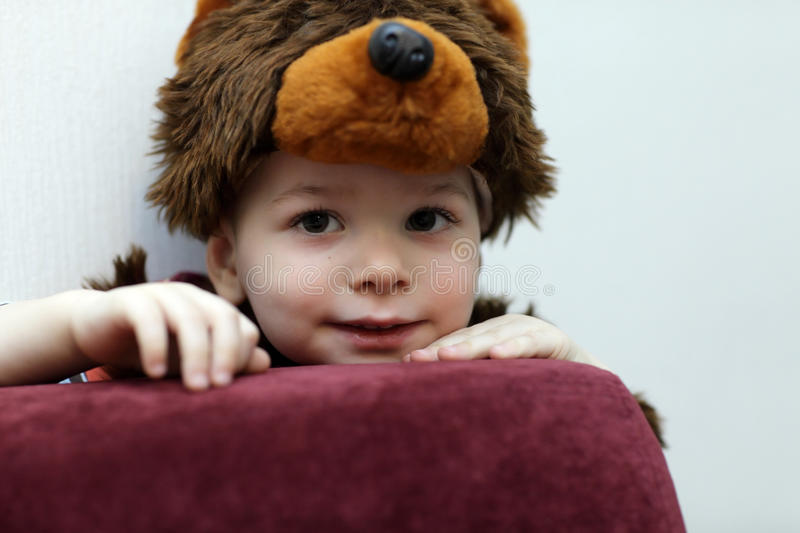 Kid in a bear suit. Portrait of a kid in a bear suit royalty free stock photo