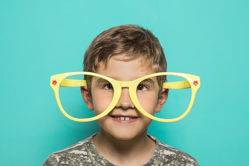 Kid with big funny glasses stock image