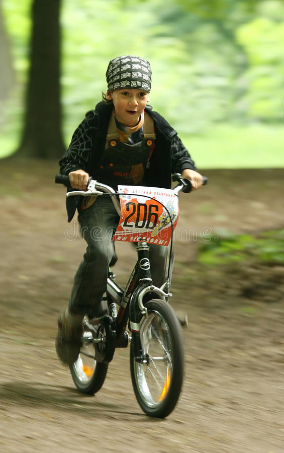 Kid on the bike. UKRAINE, KIEV - MAY 30: Alexander Andreychuk with blurred background, at the child amateur bicycle competition We are the champions, on May 30 royalty free stock photography