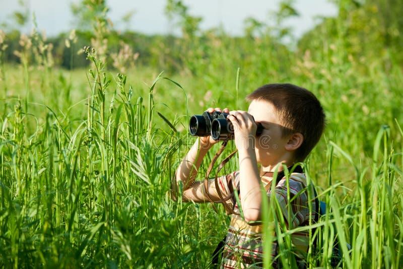 Kid with binocular stock images