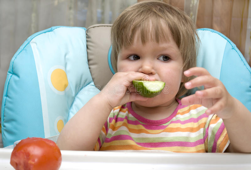 Download Kid is bite off cucumber stock image. Image of nice, expression - 20028927