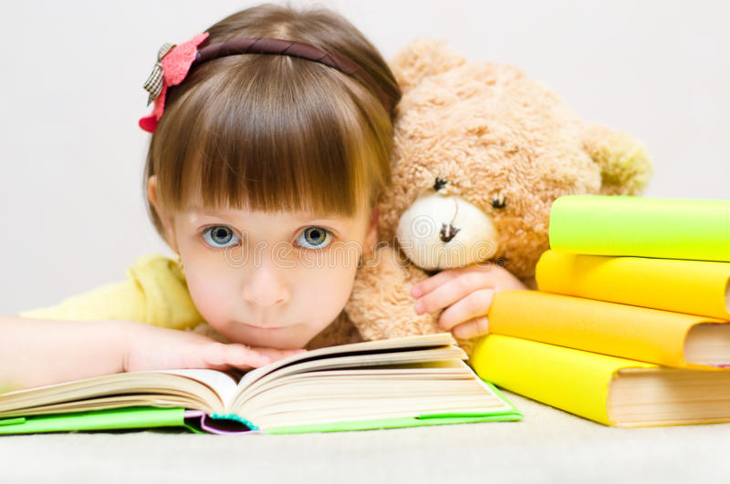 Kid with book royalty free stock photo