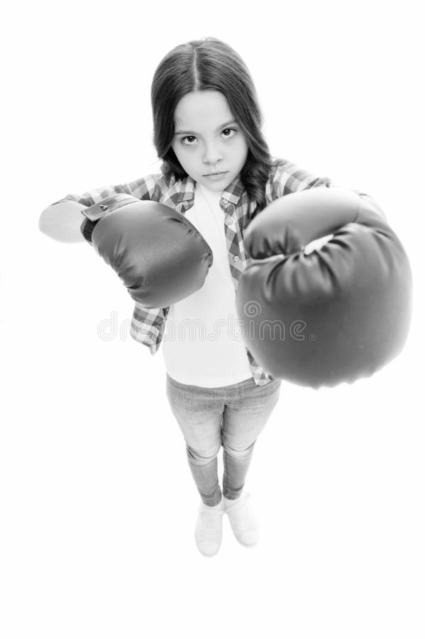 Kid boxing gloves isolated white. Child boxer defend herself. Sport activity. Boxing practice. Feminist movement. Self. Defend strategy. Attack and defend stock image