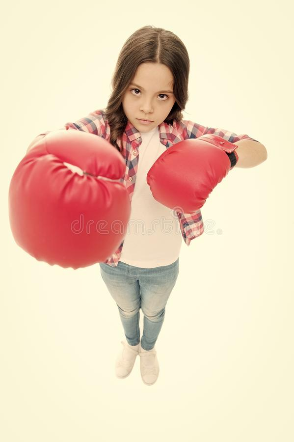 Kid boxing gloves isolated white. Child boxer defend herself. Sport activity. Boxing practice. Feminist movement. Self. Defend strategy. Attack and defend royalty free stock photo