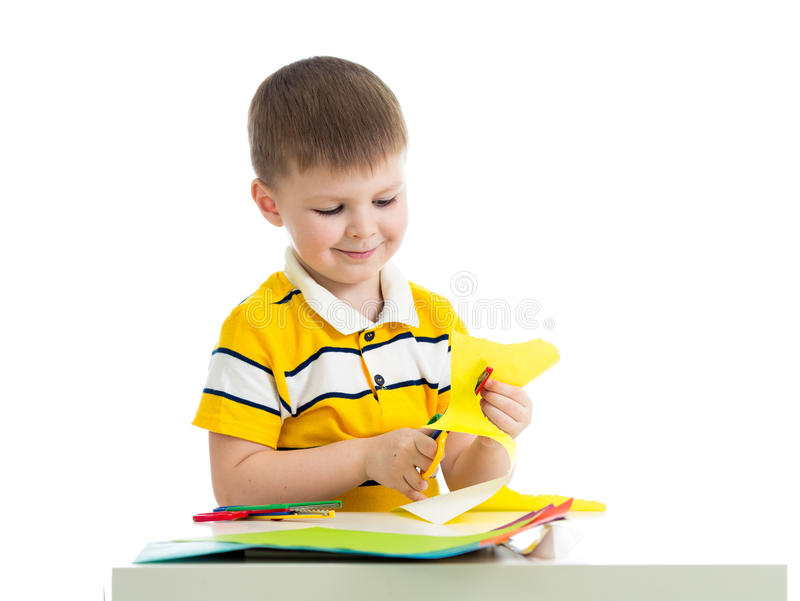 Kid boy cut paper. Isolated on white stock photography