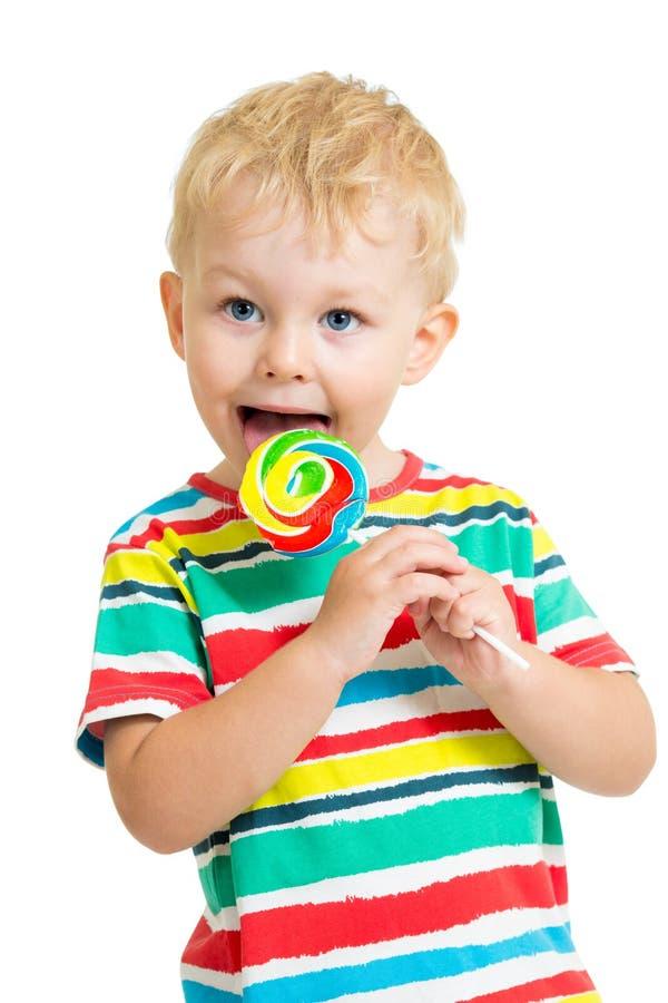 Kid boy eating lollipop isolated. Child boy eating lollipop isolated royalty free stock photography