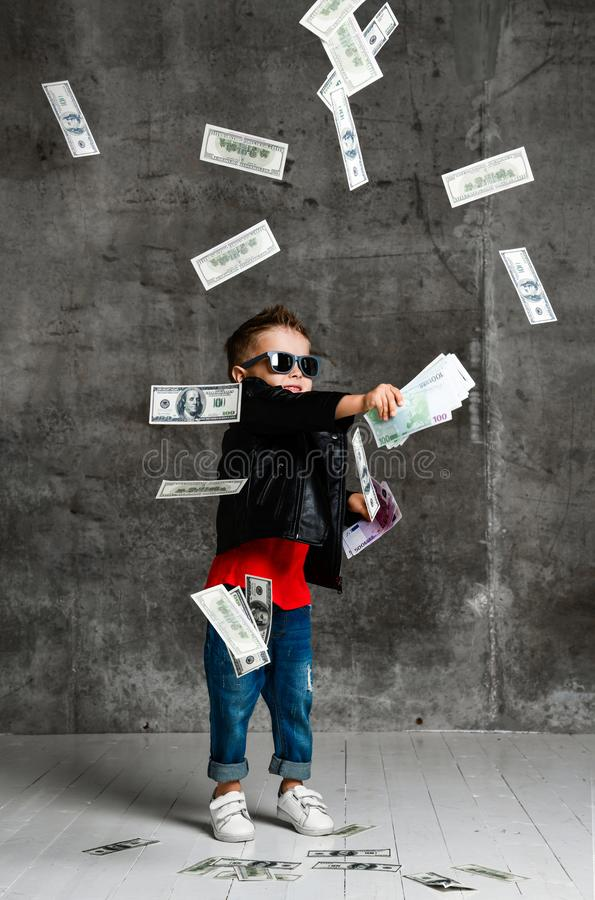 Free Kid Boy Millionaire In Leather Jacket And Jeans Is Throwing Around, Throwing In The Air Money Cash Looking It Falling Stock Image - 161066991