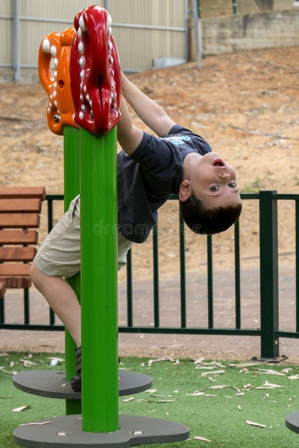 Kid boy in playground stock image