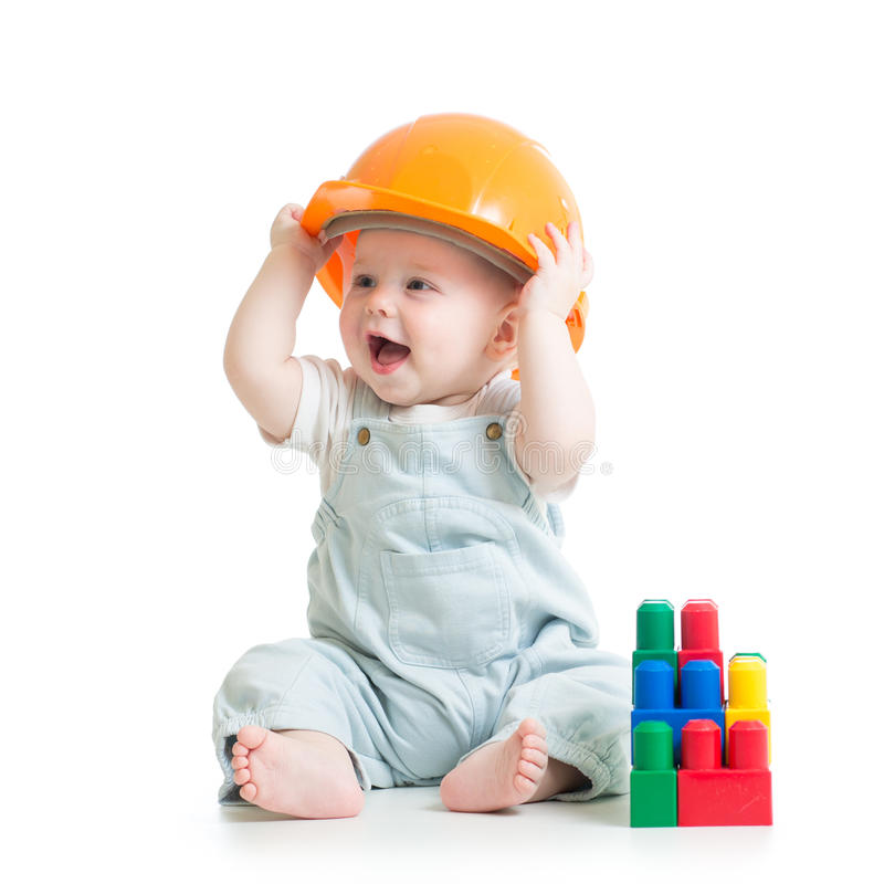 Kid boy playing with building blocks toy stock photography