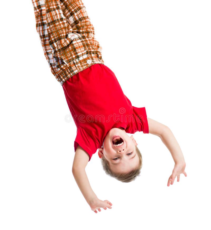 Kid boy upside down isolated stock image