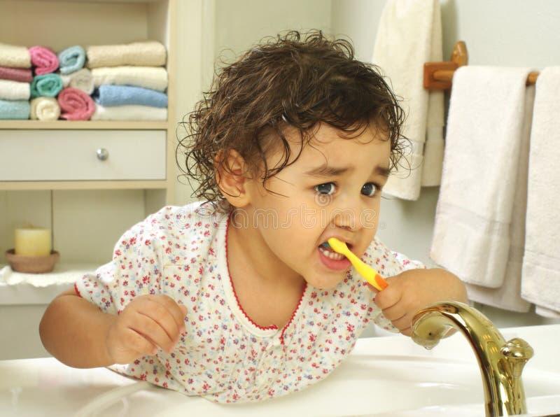 Kid brushing teeth stock image