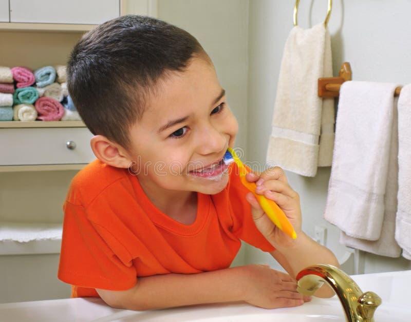 Kid brushing teeth royalty free stock photo