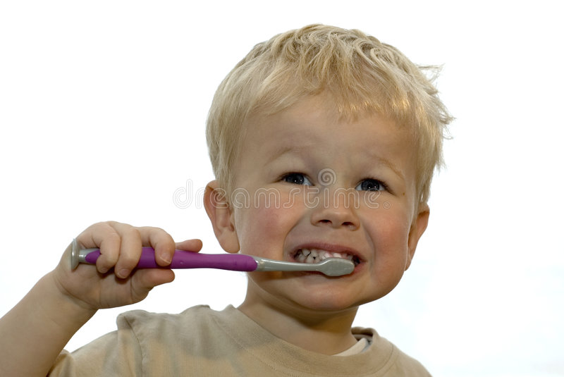 Kid brushing teeth royalty free stock image