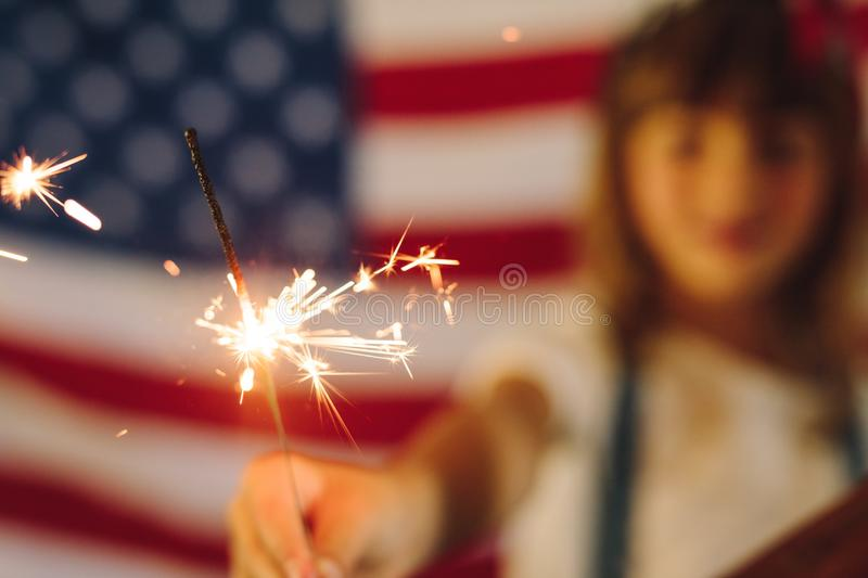 Kid burning fire crackers stock image